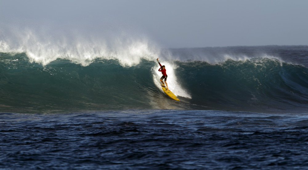 c043e84d18 A surfer catches a wave at Waimea Bay after the Memory of Eddie Aikau surfing  contest was canceled